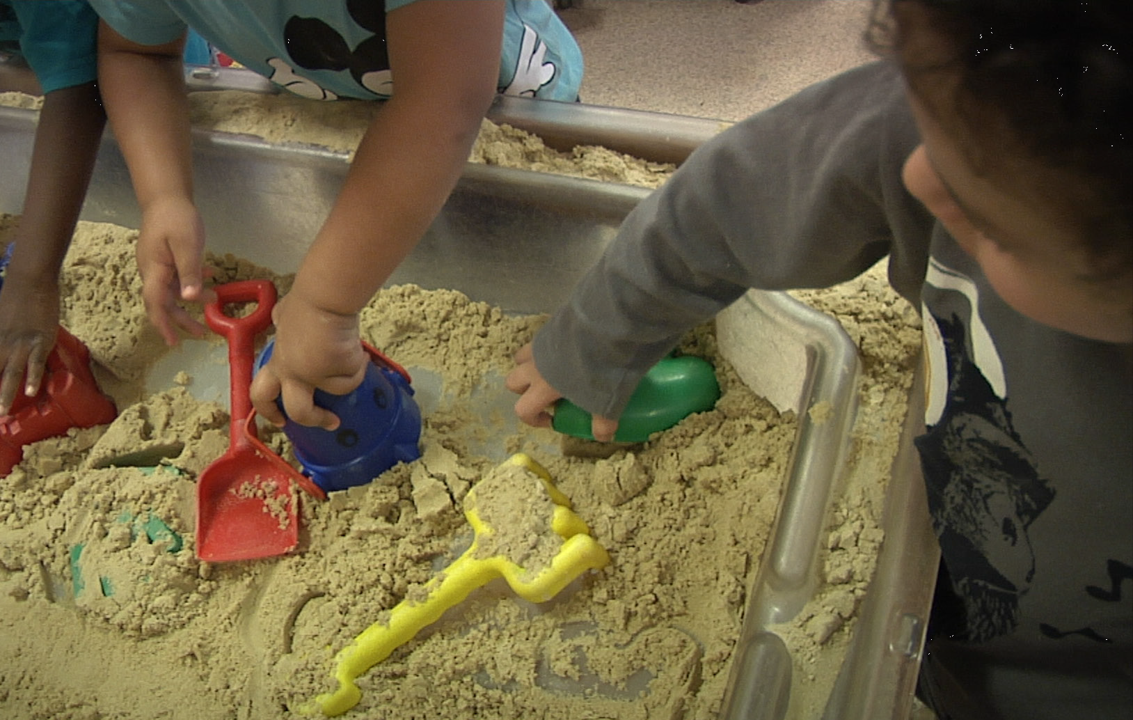 children playing in sandpit.png